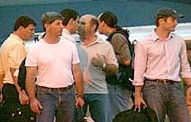 Sechs der Insassen der Legacy. Die beiden juengeren Männer im Vordergrund sind nach Angaben der Agentur die beiden Piloten