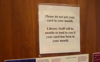 Please do not put your card in your mouth.  Library Staff will be unable to lend to you if your card has been in your mouth.