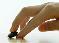 Go-spielende Hand, Foto: Martin Chrz