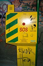 an sos-telephone on a dark street in triest, italy