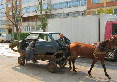 horse-pulling-a-car-in-romania