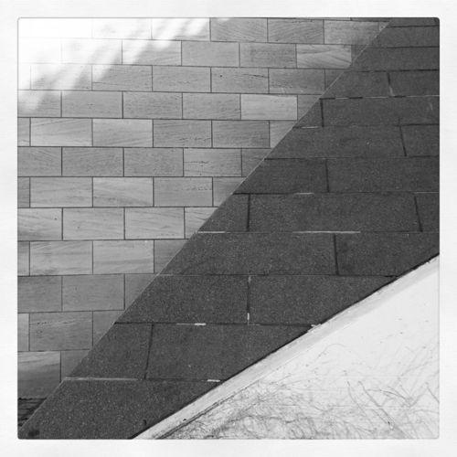 Graue Abstufungen an Mauer